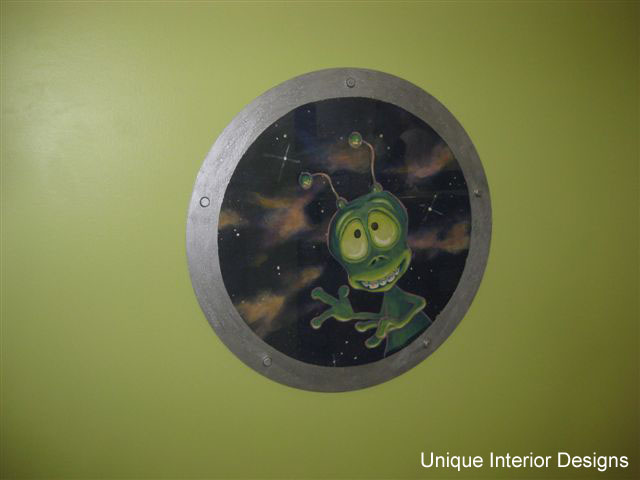 Friendly Alien Peeks Through Porthole